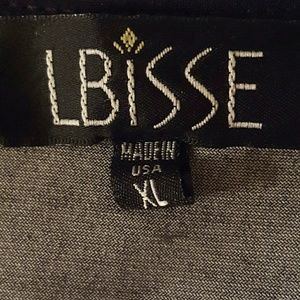 LBisse Tops - Gorgeous tunic top with sidetail hemline